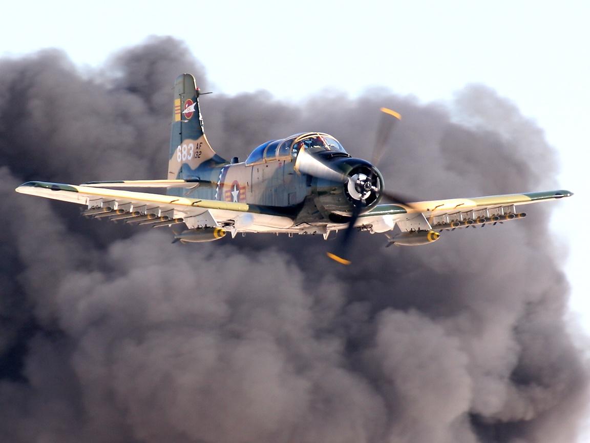 http://richard-seaman.com/Wallpaper/Aircraft/Attack/SkyraiderWithSmokeCloud.jpg